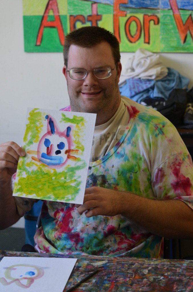 Jeffrey with cat painting at AFWB